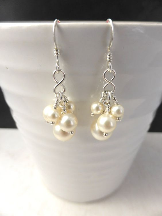 Delicate cream-rose Swarovski ELEMENTS glass pearl drop earrings made from sterling silver with beautiful pale cream beads. These Swarovski