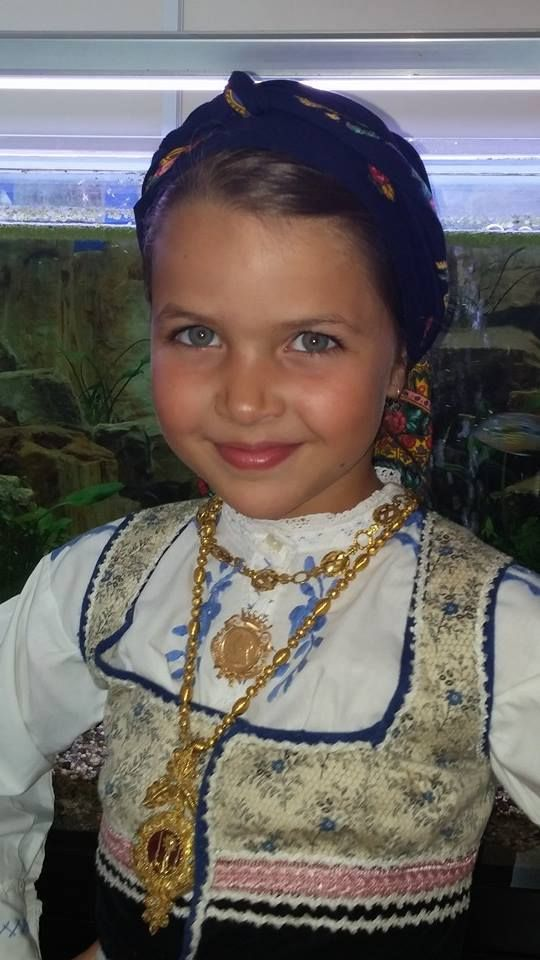A little girl in traditional Minho costume a region in the north of Portugal..: