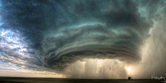 The Mothership - Supercell thunderstorm rolls accross the Montana prairie at sunset by by photographer Sean R. Heavey