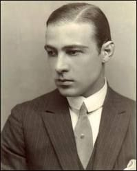 """Rudolph Valentino, circa 1920.  Rudolph Valentino (1895-1926) was an Italian actor, and early pop icon. A sex symbol of the 1920s, Valentino was known as the """"Latin Lover"""". He starred in several well-known silent films including The Four Horsemen of the Apocalypse, The Sheik, Blood and Sand, The Eagle and Son of the Sheik. He had applied for American citizenship shortly before his death.   His sudden death at age 31 caused mass hysteria among his female fans, propelling him into icon…"""
