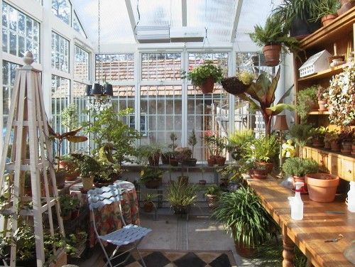 A beautiful, lively, in-home greenhouse... A room like this would surely be a great escape.: Garden Sheds,  Glasshouse, Greenhouse Ideas, Greenhouses Sunrooms, Backyard Greenhouse, Potting Sheds, Greenhouse Interior, Potting Benches, Green House