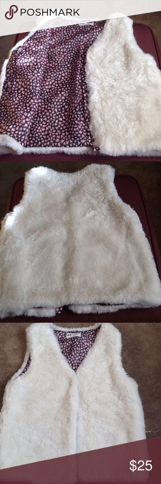 H&M Girls faux fur vest White girls faux fur vest beautiful lining so  cute.  With pink and white black.  3 snaps  in the front. Chest 34 inches and 20 inches long H &M Jackets & Coats Vests
