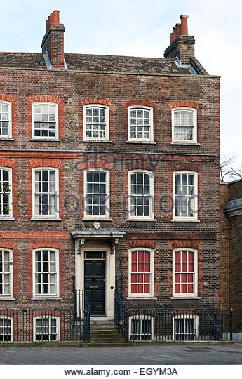 A restored Georgian end of terrace house in the Mile End Road, Tower Hamlets, London. - Stock Image