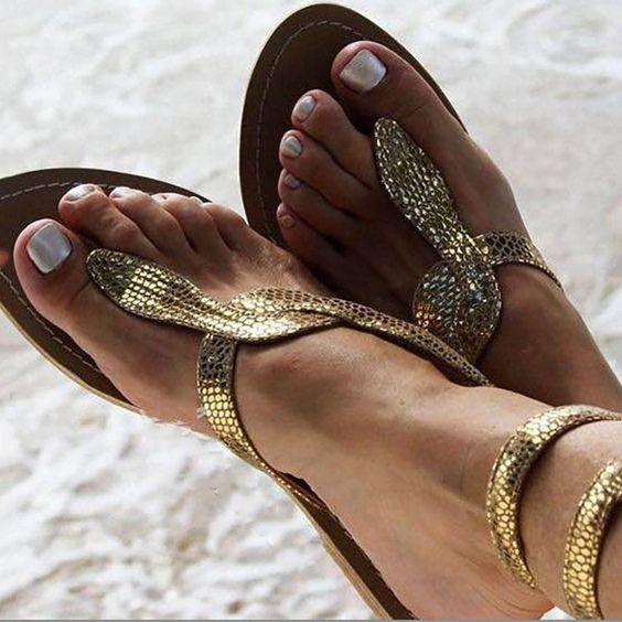 Shop Sexy Serpentine Clip Toe Flat Sandals