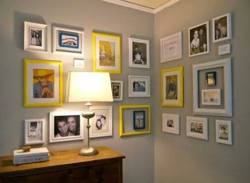 Look how this gallery wraps around the corner of the room and uses several brightly colored frames to add a punch to the collection. This would be great in a small nook, bathroom, or entryway.