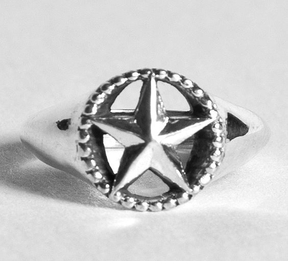 Ah, the simplicity of this ring makes it an instant classic.  The Texas Star surrounded by beads in the perfect size for the hand. This ring is crafted in Sterling Silver and is 12mm (about a 1/2 inch) in diameter at the top.  http://www.puretexan.com/mshop/index.php/by-type/sterling-silver/ladies-star-ring-in-sterling-silver.html
