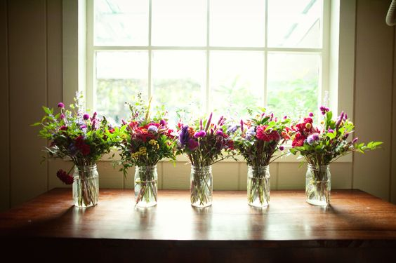 mason jar decor with wildflowers so simple and so lovely..... the repetition works......