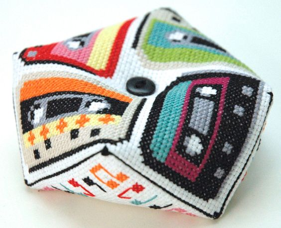 """Make a bold and bright retro cassette tape biscornu- with a colorful music note border on the reverse side. Comes with assembly instructions. This pattern arrives as an Instant Download! A few minutes after your payment is processed, youll receive a separate email with a link to download your pattern(s) immediately.  Pattern Specs: Stitch Count: 58 stitches x 58 stitches Design Area: 4.1 x 4.1 (14-count) and 3.6"""" x 3.6"""" (16-count) Stitches Used: Cross Stitch, Back Stitch, Whip Stitch (for…"""