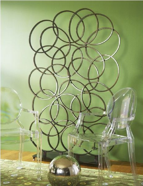 The Dotz Screen is a whimsical and yet very dynamic way to separate spaces in a small room or apartment. It can also be used to stage a nook or add an artful feel to the room. || Dotz Screen furniture.cort.com