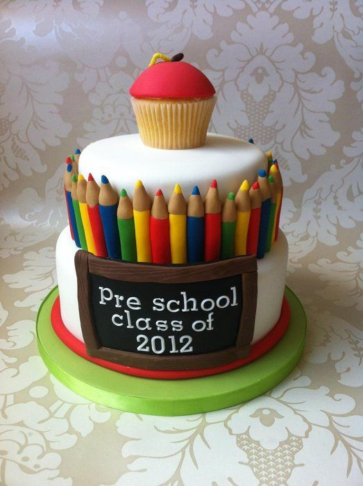 A preschool cake with pencils, blackboard and an apple cupcake topper. Perfect for back to school!