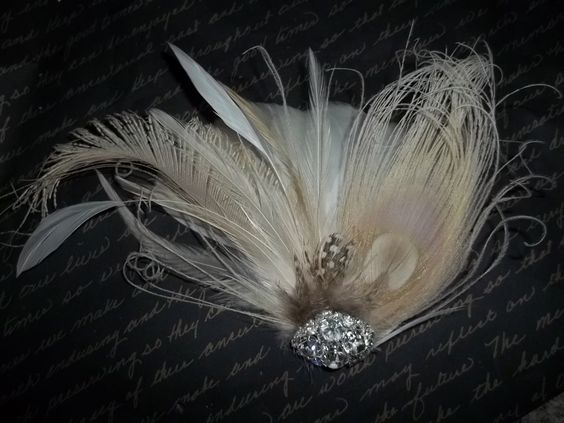 My Ivory Peacock Bridal Hair Fascinator - Ivory Sword Feather - Rhinestone Accents from Etsy; I switched from my cathedral-length veil to this fascinator at the reception