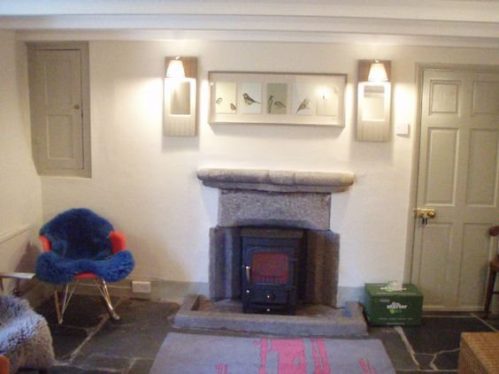 Clearview Pioneer installed into a traditional stone fireplace by Kernow Fires in Cornwall   #clearview #pioneer #fire #stove #freestanding #multifuel #burner #traditional #fireplace #stone #hearth #surround #kernowfires #wadebridge #redruth #cornwall