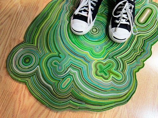 Rug made out of thins strips of felt and hot glue! Great idea!