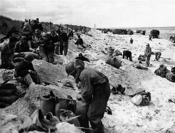 Members of a U.S. Navy Beach Battalion dig in and arrange gear for their first night ashore in France on June 9, 1944. (AP Photo) - ( Omaha Beach ? Utah Beach ? )