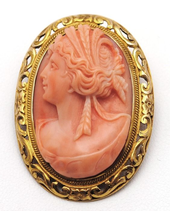 14k yellow gold engraved, floral bezel framing a peachy-pink coral cameo, circa 1930s-40s, hallmarked by one of San Francisco's oldest and most renowned jewelry stores, Shreve & Co.  $1,195.