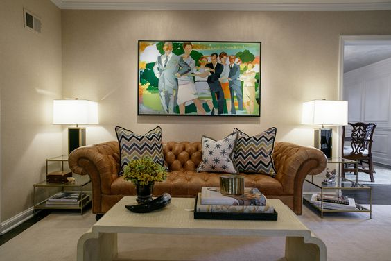 An unexpected color palette and mix of textures warm up this family-friendly living room.  -RLR Interiors