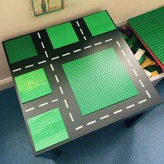 Lego table created using an IKEA lack table, Lego baseplates and white labels Simple (and cheap!) but effective!