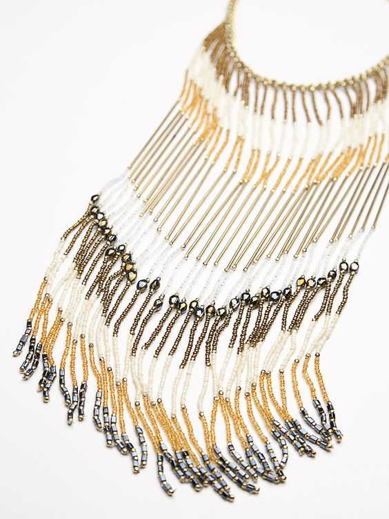 Desert Rains Statement Necklace | Statement necklace featuring exaggerated fringe bib with drippy glass bead accents. Adjustable lobster clasp closure for an effortless fit.