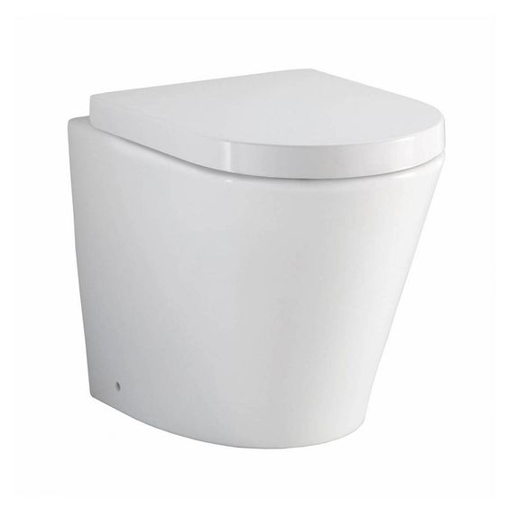 Arc back to wall toilet
