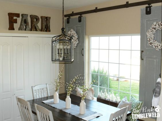 Front windows sliding barn doors and the o 39 jays on pinterest for Barn door window covering