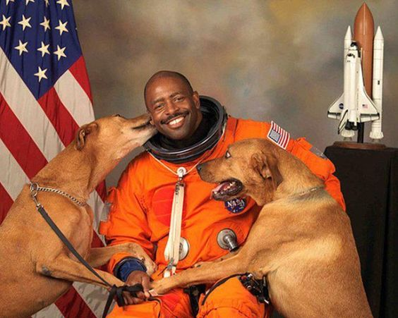 Astronaut Leland Melvin was able to sneak his two rescue dogs onto the official photo shoot for his NASA portrait