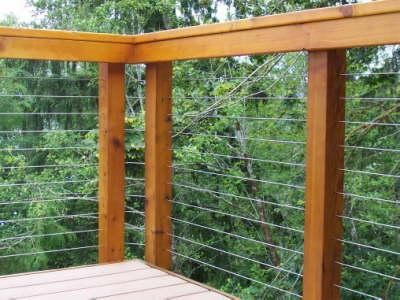 Cable railing requires strong posts to support the high-tension ...