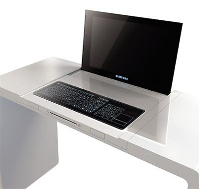 This looks like the very thin monitor lifts up from the desk to reveal the keyboard. I would really like this!