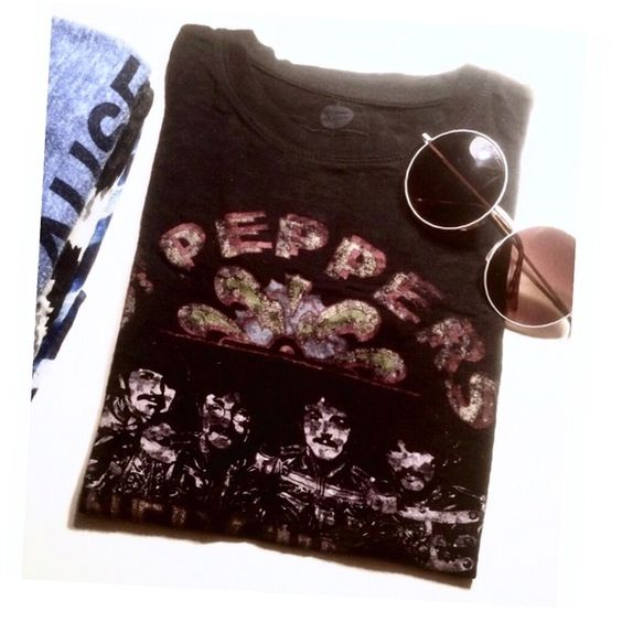 cute black sheer Beatles burnout T-Shirt Who doesn't LvE the Beatles?! Amazing Fit with this Tee! It's like the perfect size medium fit possible! Black Sheer burnout material..but not super thin material like many in that style..which is what I ❤️ about it! Perfect for all seasons to throw over your favorite color tank, and a cool pair of jeans. Worn only twice. Perfect condition. High quality. {LONELY hearts club band.} Tops Tees - Short Sleeve