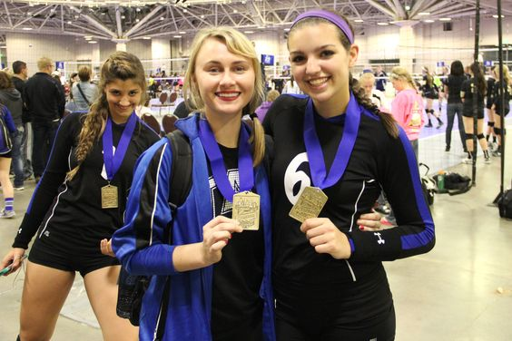 #12- Pic with your coach- Proud of those medals with our club coach Corinne who played for the Northern Lights Volleyball Club and is from Minnesota but now resides in Texas!!! Corinne had family out to visit and cheer for our team. Very nice :)....Oh, and photo-bombed by Savy!!: