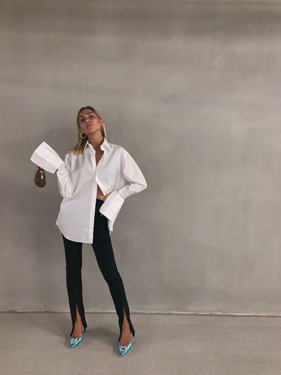 Athens-based fashion influencer Natalia Georgala sporting our Signature Shirt in White. #fashionblogger #woera #fashioninfluencer #streetstyle #whiteshirt #signatureshirt #aminamuaddi #nataliageorgala #zarapants