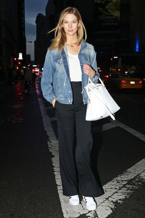 Supermodel Karlie Kloss dresses down her white t-shirt and black pants with a boxy Mother denim jacket.: