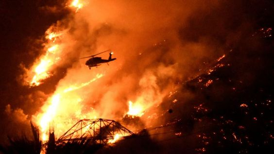 Two Los Angeles-area Wildfires Threaten to Merge after Forcing Evacuations