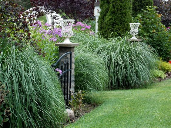 Re-purposed house pillers into Garden post and grasses