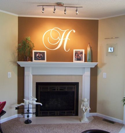 Love the initial above the fireplace. This one is vinyl, but could easily paint one too!