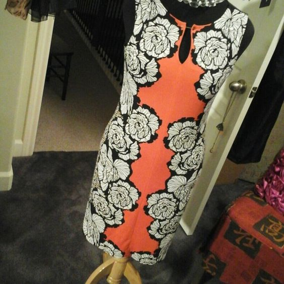 Darling botanical dress,  by Worthington! This beautiful dress is rich coral color,  Surrounded by black and white huge flowers! A flattering,  slimming, dress. Worthington Dresses