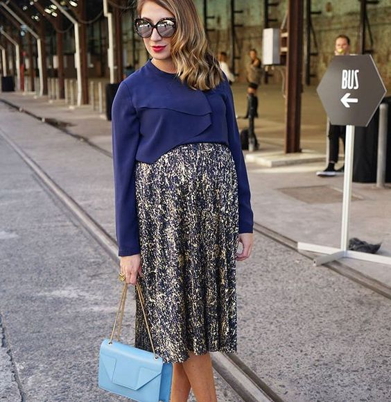 Pin for Later: 38 Superchic Maternity Outfits to Help You #StyletheBump A Cropped Jumper Over a Midi Dress