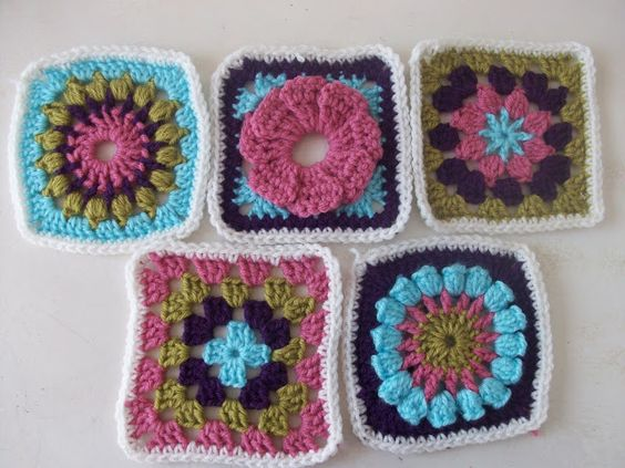 Eclectic Granny Square Blanket.  The blanket consists of five different granny square motifs, in 4 coordinated colors.   Pattern here http://www.allfreecrafts.com/crochet/afghans/granny-square-afghan.shtml