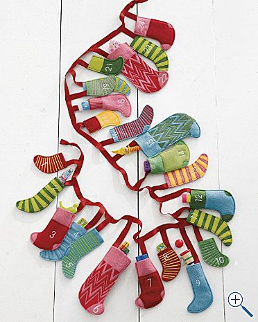 Mini Felt Stockings Advent Calendar from Garnet Hill.com $78.00 Embroidered with white numbers: