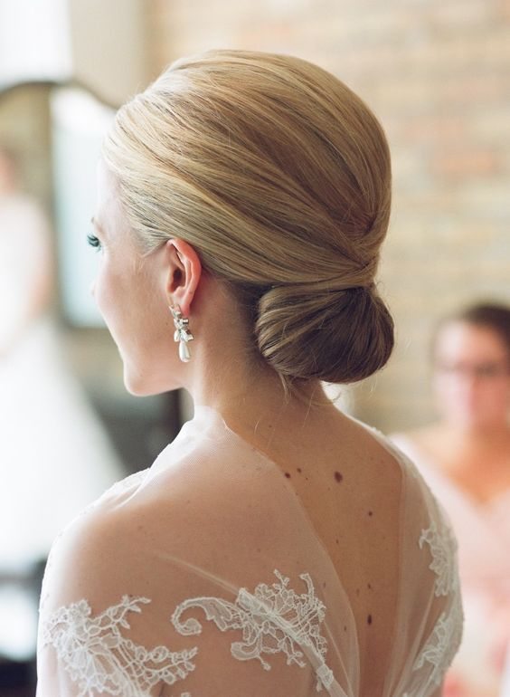 classic low bun wedding bridal updo hairstyle ideas: