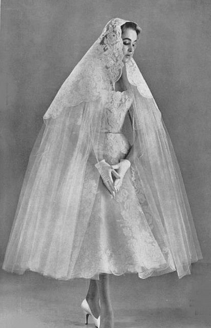 1955 short wedding dress and veil by Jacques Decaux.:
