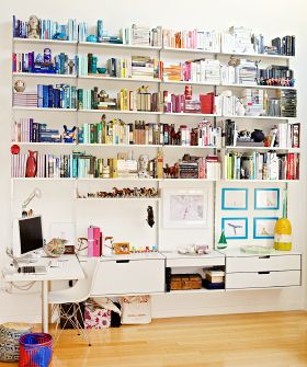The nerd in us is really freaking out over this beautifully color coded bookshelf.