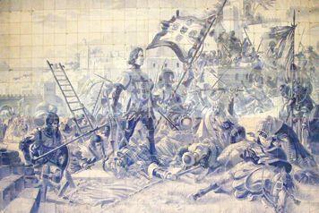 O INFANTE D. HENRIQUE NA CONQUISTA DE CEUTA (1933). Painel de azulejos de Jorge Colaço (1864-1942) na Estação de São Bento, no Porto.