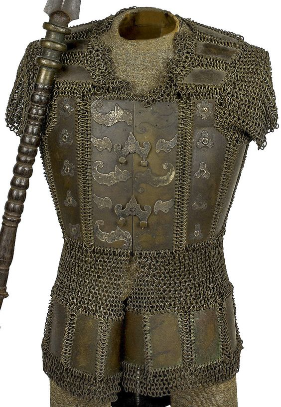 moro philippine brass mail and plate cuirass century complete with bosses and metal furniture attached to the breastplate with two functional fasteners brass and metal furniture