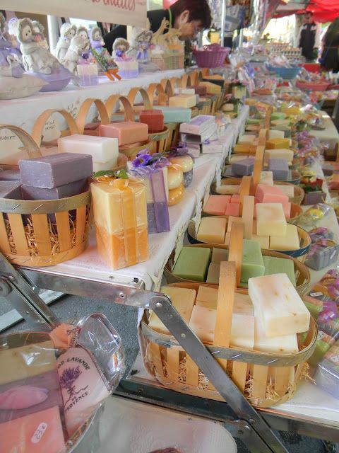 Baskets of beautiful, colorful handmade soaps make for a very welcoming market display.