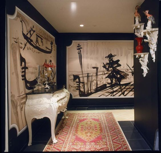 HUTTON WILKINSON, TONY DUQUETTE INC., CREATED THIS ENTRANCE HALL IN AN APARTMENT ON THE WILSHIRE CORRIDOR, WITH LARGE SCALE BLOWUPS OF ORIGINAL TONY DUQUETTE PEN AND INK DRAWINGS OF VENICE, CENTERED BETWEEN BLACK LACQUERED WALLS.  A SECRET DOOR TO A POWDER ROOM, IS HIDDEN BEHIND THE LEFT HAND CORNEER OF THE FAR MURAL.