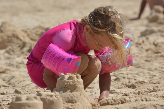 A girl building sandcastles on the beach