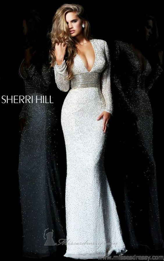 Sherri Hill. Floor length glitzy gown, long sleeves, embellished bust, and a deep v-neck.