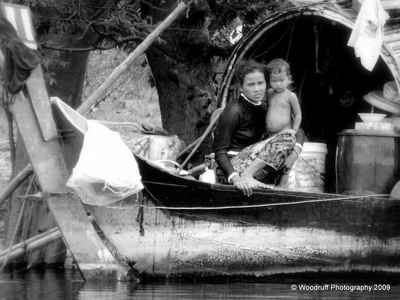 Mother and child on houseboat on the MeKong RIver