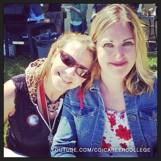Ladies posing for the camera at the student appreciation event in Victoria, BC #Victoria #BC #Canada #college #campus #posing #ladies #smiling #smile #grin #laugh #amused #delighted #happy #pleased #simper #smirk #CDICollege #appreciation #event