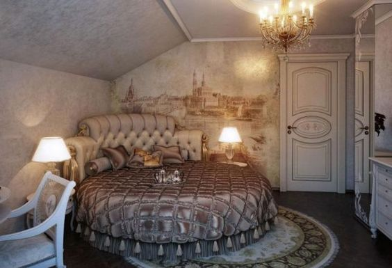 Fabulous wall mural and exqusite interiors create a ravishing traditional bedroom with a round bed.